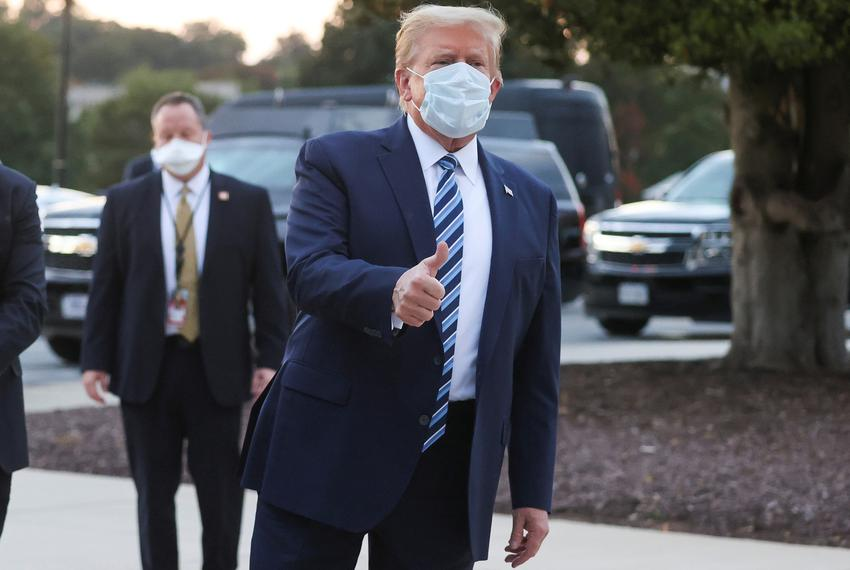 President Donald Trump gives a thumbs-up as he departs Walter Reed National Military Medical Center after the fourth day of …