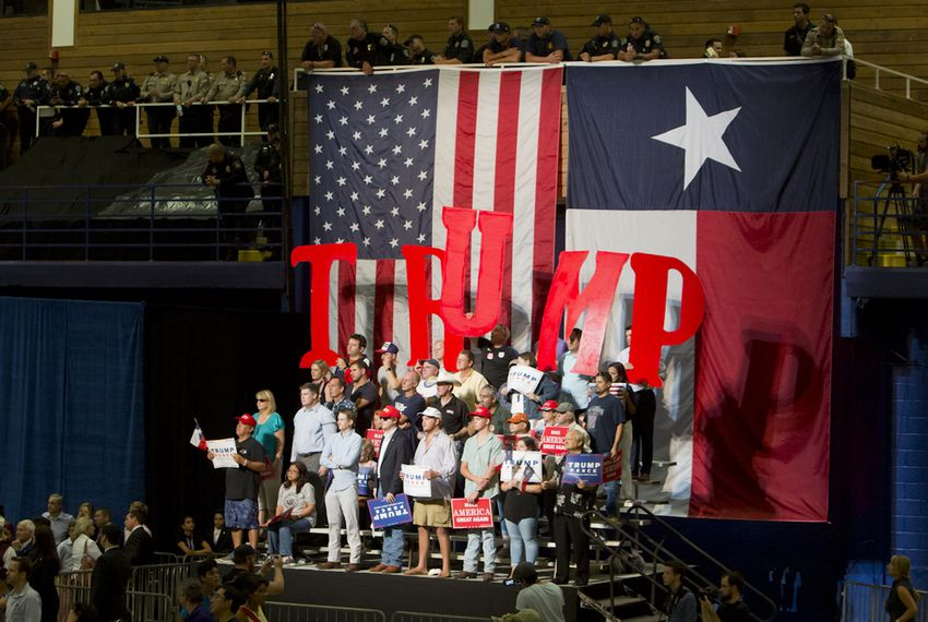 Supporters of Republican Presidential nominee  Donald Trump, hold up letters to spell his name during an August 23, 2016 rally in Austin, Texas