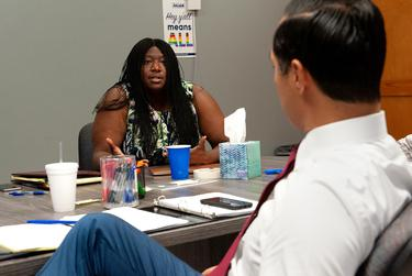 Maya Rupert, campaign manager for Julián Castro, talks to the candidate during a recent meeting.