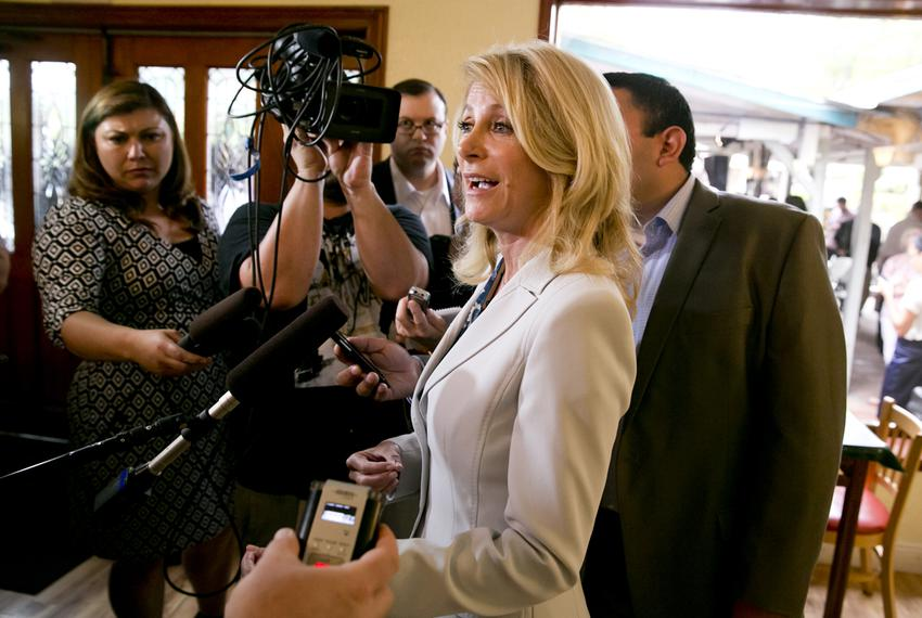 Democratic gubernatorial candidate Wendy Davis, speaks media during a campaign stop at East Austin restaurant Juan in a Mill…