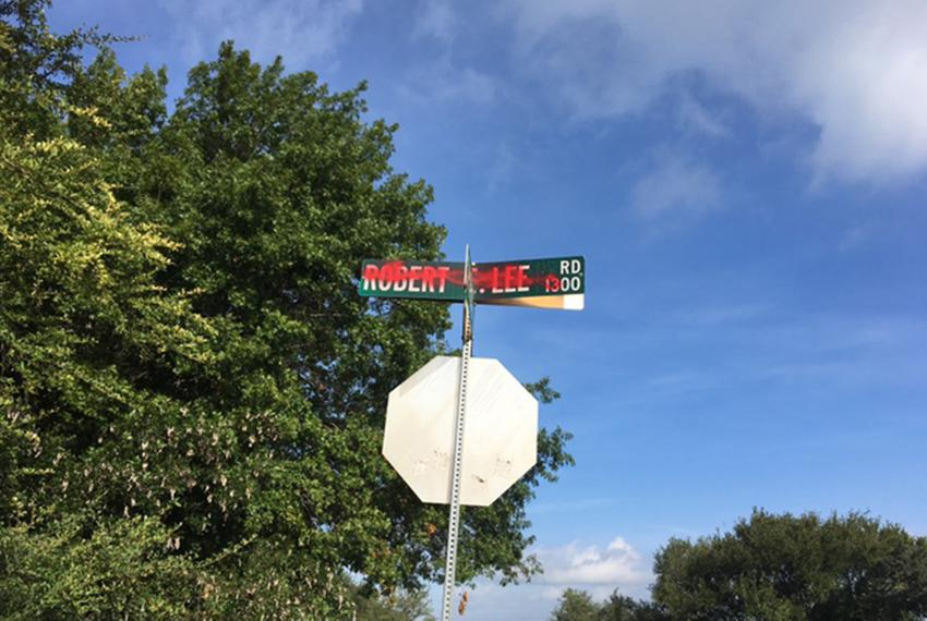 Most signs on Robert E. Lee Road in South Austin were spray painted over Monday morning following the deadly gathering of wh…