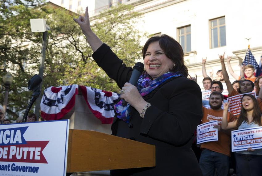 "Lt. Gov. candidate Leticia Van de Putte, D-San Antonio, flashes ""Hook 'em Horns"" at a UT rally April 7, 2014."