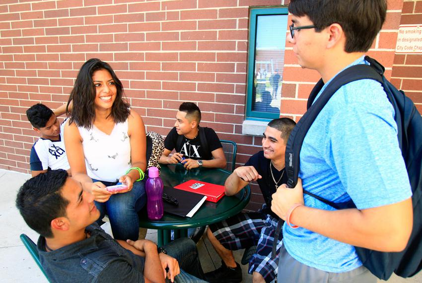 Freshman Samantha Salas (center) hangs out with friends before going to class on the first day of school on Aug. 25, 2014, a…