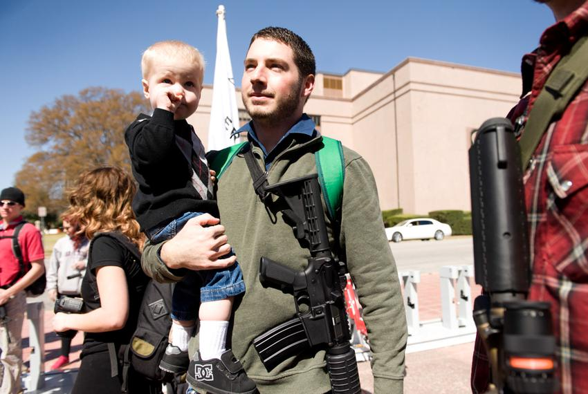 Chris Way and his son Ryan, 2, participate in a march during South by Southwest in March 2014, an event led by the Austin ch…