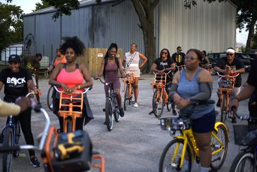 Bike riders listened to instructions before a Juneteenth bike ride  in Houston on June 18, 2021.
