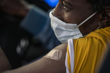 Necole Williams has a band-aid covering her injection site at a 24-hour vaccination event at Kelly Reeves Athletic Complex on March 6, 2021, in Austin. Family Hospital Systems hosted the drive-thru vaccine event with an 80s theme and equipped to vaccinate 7,000 people.