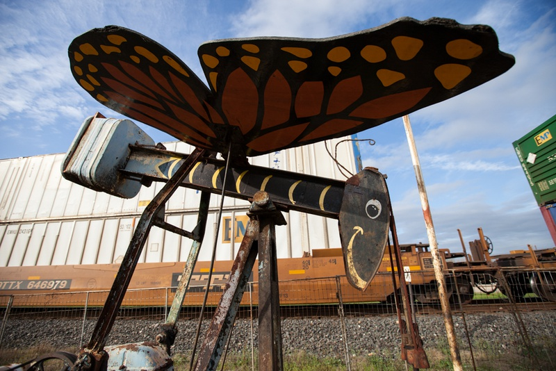 This butterfly, which gently flaps its wings when the pump is turned on, is one of Luling's older pump jack installations.