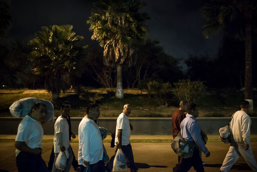 A group of undocumented Mexican national ex-offenders enter Mexico at the US-Mexico border crossing at Brownsville/Matamoros after being deported from the United States on Nov. 4, 2015.