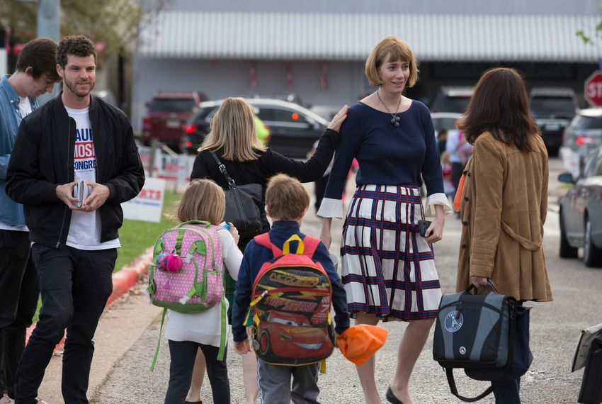 Laura Moser, Democratic primary candidate for the 7th Congressional District, greets primary voters outside an elementary school in the West University area in Houston on March 6, 2018.