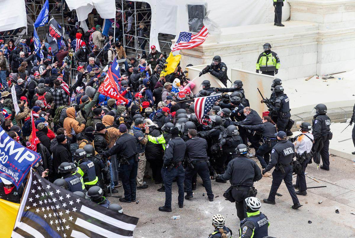 Pro-Trump rioters and police clashed at the U.S. Capitol building in Washington, D.C. on Jan. 6, 2021. The mob broke windows and breached the Capitol building in an attempt to overthrow the results of the 2020 election. Police used buttons and tear gas grenades to eventually disperse the crowd. Rioters used metal bars and tear gas as well against the police.