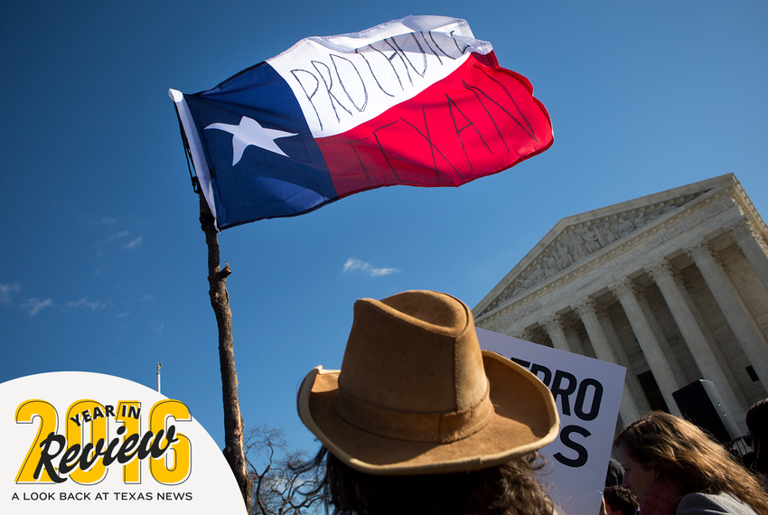 """Daniil Eliseev, 19, from Dallas holds a flag reading """"Pro Choice Texan"""" in front of the U.S. Supreme Court as Whole Woman's Health v. Hellerstedt is argued inside on March 2, 2016. The case focused on a 2013 Texas law known as House Bill 2, which led to the closure of more than 20 abortion clinics. The court overturned the law."""