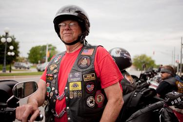 Edwin Top of Orange City, Iowa, prepares to ride from Perry to Boone, Iowa, on June 6, 2015, as part of the Ride with Rick event. The fundraiser benefited the Puppy Jake Foundatiom, an organization that provides service dogs to wounded war veterans. Top served as a teletype operator in France and Germany during the Vietnam War and now serves in honor guards at veterans' funerals around Iowa.