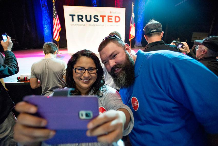 Cassandra and Brent Payne of Garland photograph themselves at the foot of the stage before U.S. Senator Ted Cruz's appearanc…