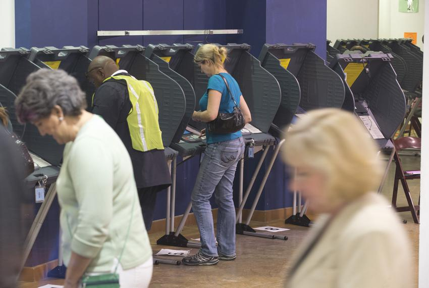 Texans cast their ballots at the Highland Mall mega-center voting site on Nov. 4, 2014.