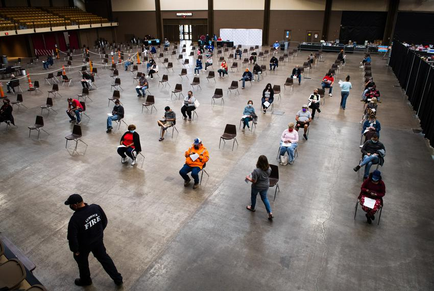 Recipients of the Moderna vaccine sit in the observation area of the Lubbock Memorial Civic Center on April 14, 2021.