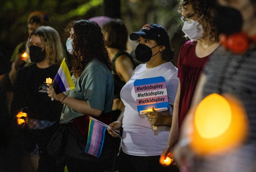 Supporters and activists gather at the front of the Governor's Mansion for the Lights in Darkness demonstration on Oct. 12, …