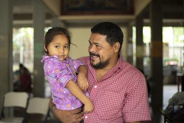 Walter Sanchez Reyes holds his daughter Maria Dolores Sanchez at a migrant shelter in southern Mexico. Sanchez was shot by gang members while driving a bus in Tegucigapla, Honduras. The family plans on requesting asylum in the United States. Nov. 16, 2019.