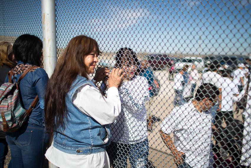 Maria Guadalupe Garcia Rodriguez of Juarez holds the hand of her daughter through the border fence in Juarez, Monday, Februa…