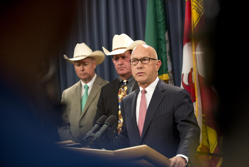 Flanked by sheriffs Brian Hawthorne of Chambers County and Andy Louderback of Jackson County, State Sen. John Whitmire, D-Ho…