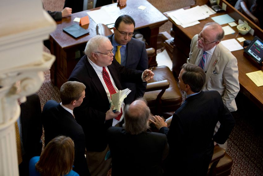 Texas House Parliamentarian Chris Griesel and Speaker Joe Straus with several other House members on dias May 1, 2015