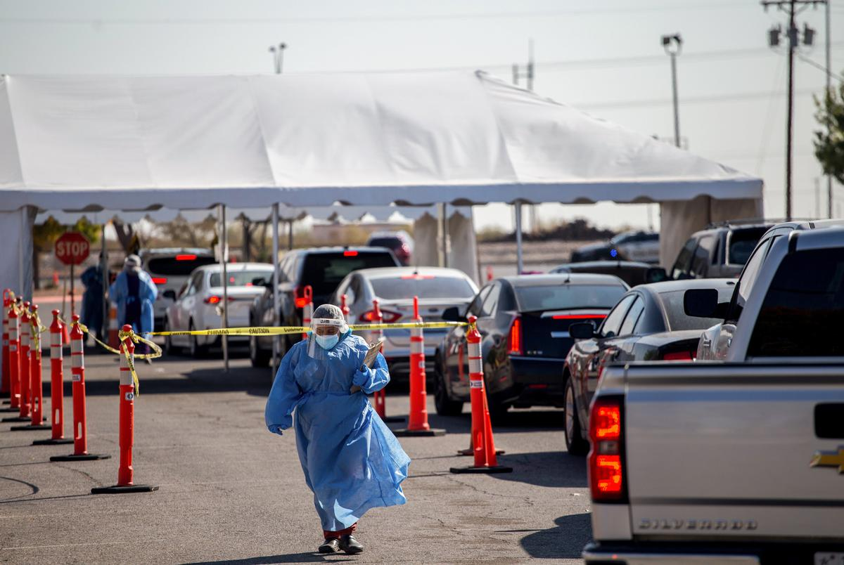 A medical personnel weara personal protective equipment as they register residents at a COVID-19 testing site at Nations Tobin Park in El Paso on Nov. 19, 2020.