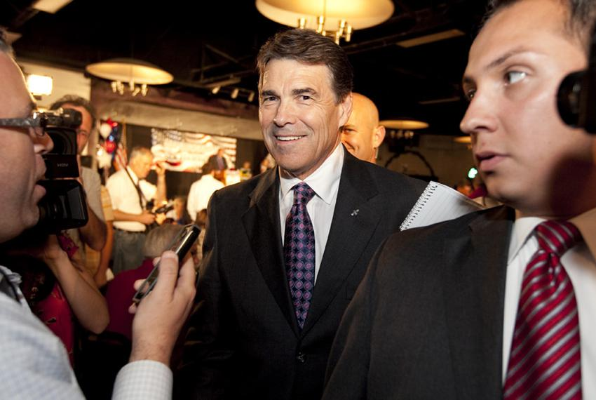 Gov. Rick Perry enters the Electric Park Ballroom in Waterloo, Iowa, during a three-day campaign swing through the Hawkeye S…