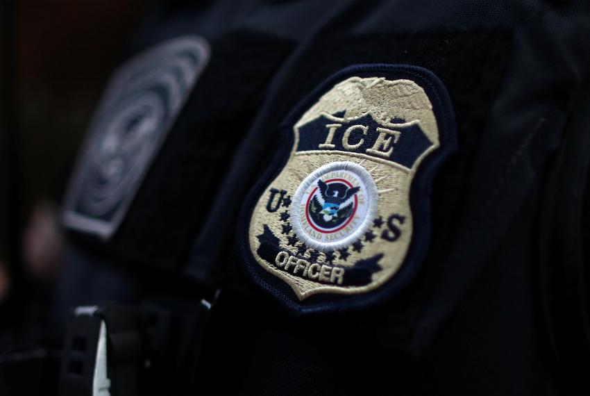 A U.S. Immigration and Customs Enforcement badge.