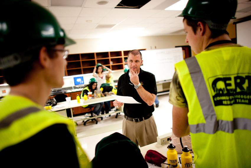 Denton ISD Advanced Technology Complex disaster response teacher, Jeff Arrington, works hands on with his students during a …