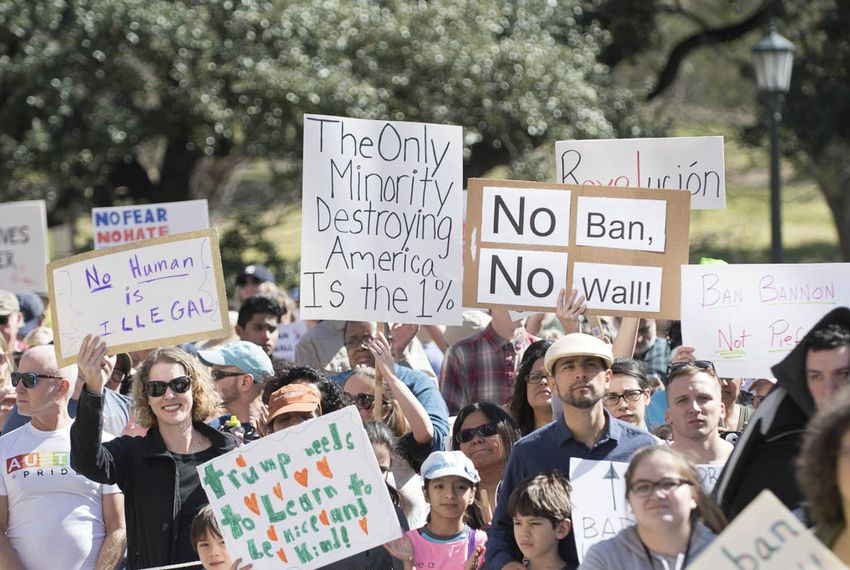 Protesters at the Texas Capitol on Feb. 25, 2017, carry a wide variety of signs denouncing Donald Trump's immigration policy and the divisiveness sparked by recent immigration raids in Texas.