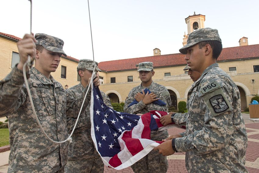 Texas A&M Kingsville Army ROTC cadets  (l-r) Andrew Wilson, Nathaniel Estes, Octavio Calleja-Ponce, Daniel Obrego and Cristian Barriosalas raise the flag in front of Texas A&M Kingsville's College Hall on October 26, 2016.