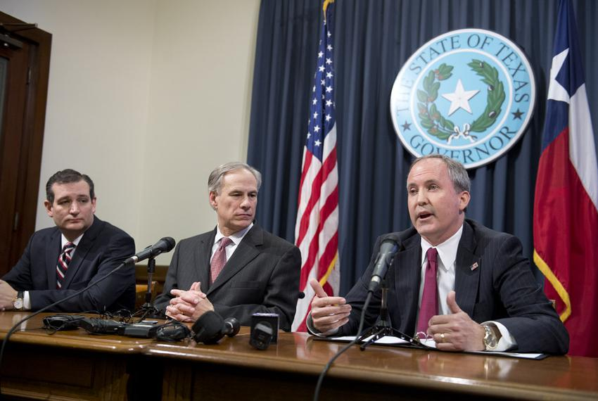 Attorney General Ken Paxton, r, with U.S. Sen. Ted Cruz and Gov. Greg Abbott during the press conference praising federal Ju…