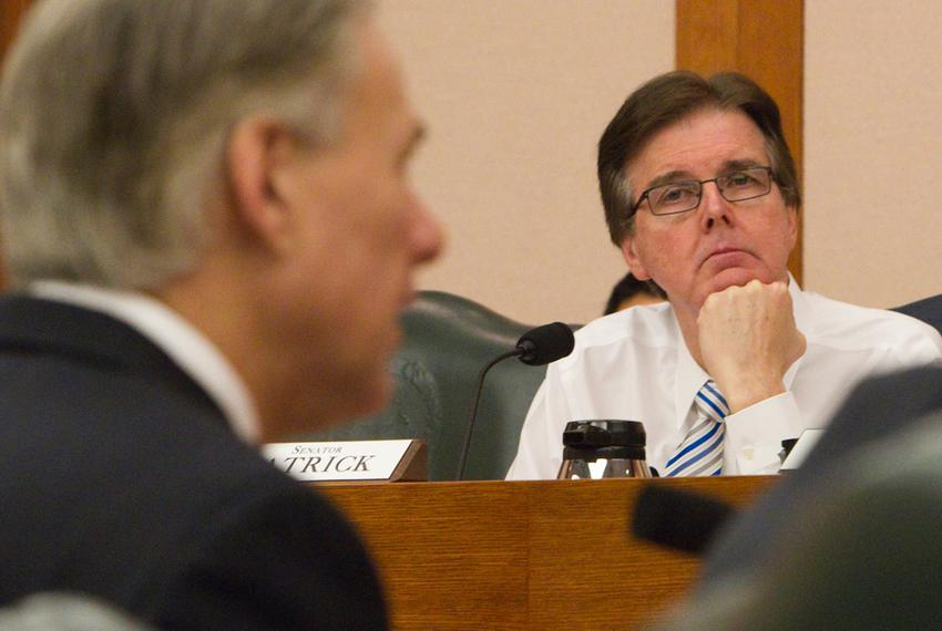 Sen. Dan Patrick R-Houston, listens to Attorney General Greg Abbott during a Senate Finance Committee hearing on Feb. 5, 2...