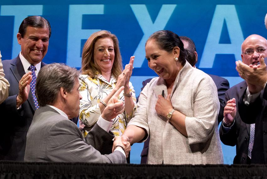 Gov. Rick Perry and Juliet García of the University of Texas at Brownsville at a signing ceremony on July 16, 2013, for th...