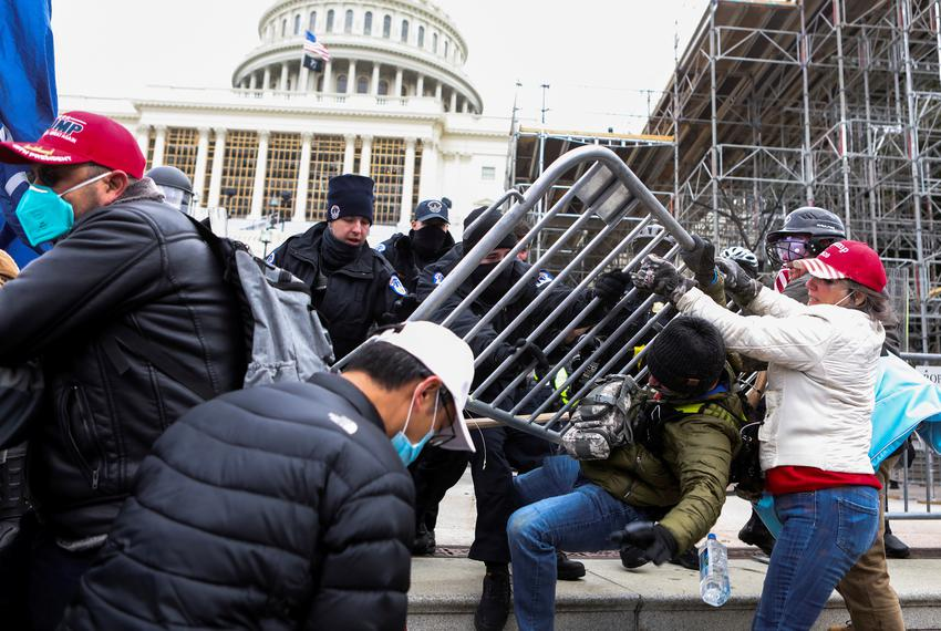 Law enforcement officers pushed back against Pro-Trump rioters attempting to enter U.S. Capitol during a protest against the…