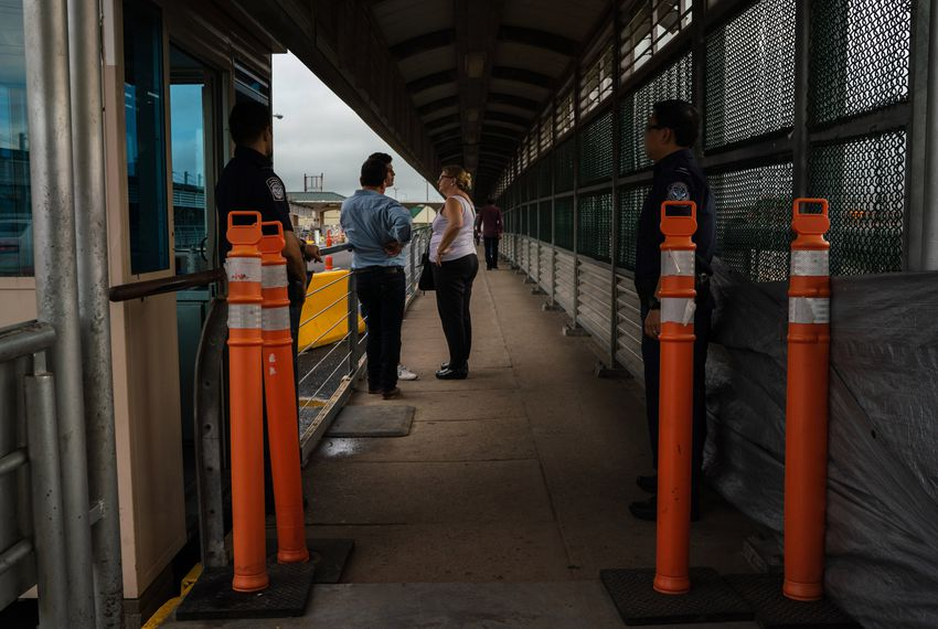 Immigration attorney Jodi Goodwin, center, talks to Nicaraguan asylum-seekers while they wait for Customs and Border Protection agents on the U.S. side of the international bridge in Hidalgo on Sept. 15, 2018.
