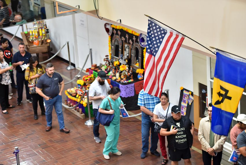 A long line of voters wait to cast their ballots at the Wonderland of the Americas Mall in San Antonio late Friday afternoon, Nov. 2, the last day of early voting.