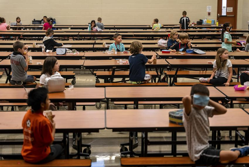 Students sit at socially-distanced intervals in the lunch room at Jacob's Well Elementary School in Wimberley on Sept. 4, 20…