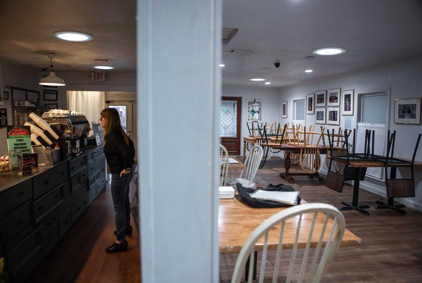 Brentwood Social House owner, Suzanne Daniels. speaks with her employees. The coffee shop has cut its hours of operation, cl…