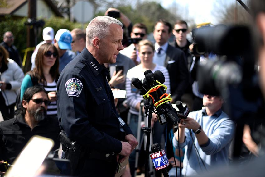 Austin Police Chief Brian Manley speaks during a news conference near the scene where a woman was injured in a package bomb …