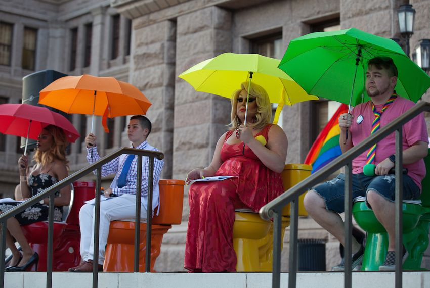Activists from Austin's LGBT community protested proposals to restrict bathroom use for transgender people on the steps of the Texas Capitol on June 28, 2017.