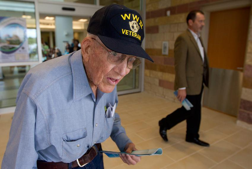 A World War II veteran from central Texas leaves the lobby area during grand opening festivities of a new Veteran's Administ…