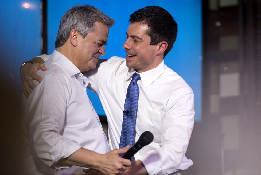 Austin Mayor Steve Adler welcomes presidential candidate Pete Buttigieg to the stage during a campaign stop at Buford's Beer Garden in Austin on Aug. 10, 2019.
