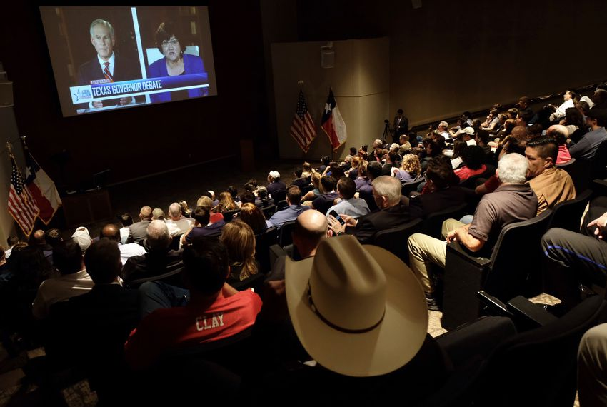 An audience watches the only Texas gubernatorial debate between incumbent Gov. Greg Abbott and Democratic challenger Lupe Valdez, in Austin, Texas on Friday, Sept. 28, 2018.