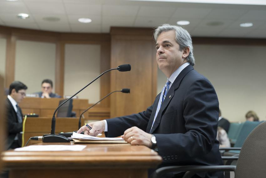 Austin Mayor Steve Adler testifies during a House committee hearing over a bill that would pre-empt local regulations on rid…