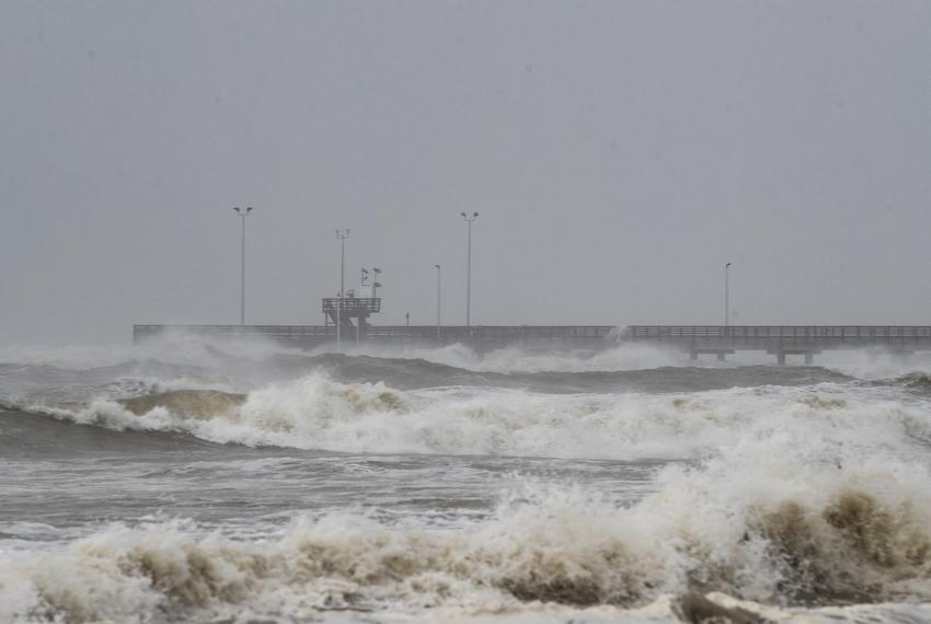 Tides rise at Bob Hall Pier in Corpus Christi as Hurricane Hanna approaches land on Saturday.