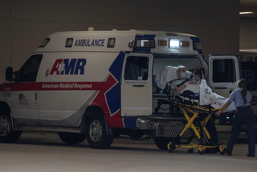A man on a stretcher is put into an ambulance at the Texas Medical Center in Houston on June 26, 2020.