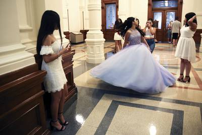 Eliana Peña wears her quinceañera dress for photos at the Texas Capitol on May 26, 2019.