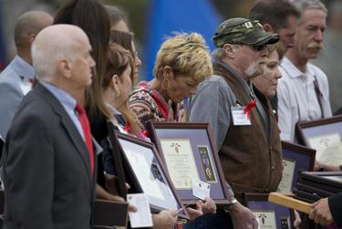 Family members of those killed in 2009 during the Fort Hood shooting receive their awards at a ceremony on April 10, 2015. At the ceremony, 42 Purple Hearts and two of its civilian counterpart — the Defense of Freedom Medal — were presented to those killed and wounded in action.