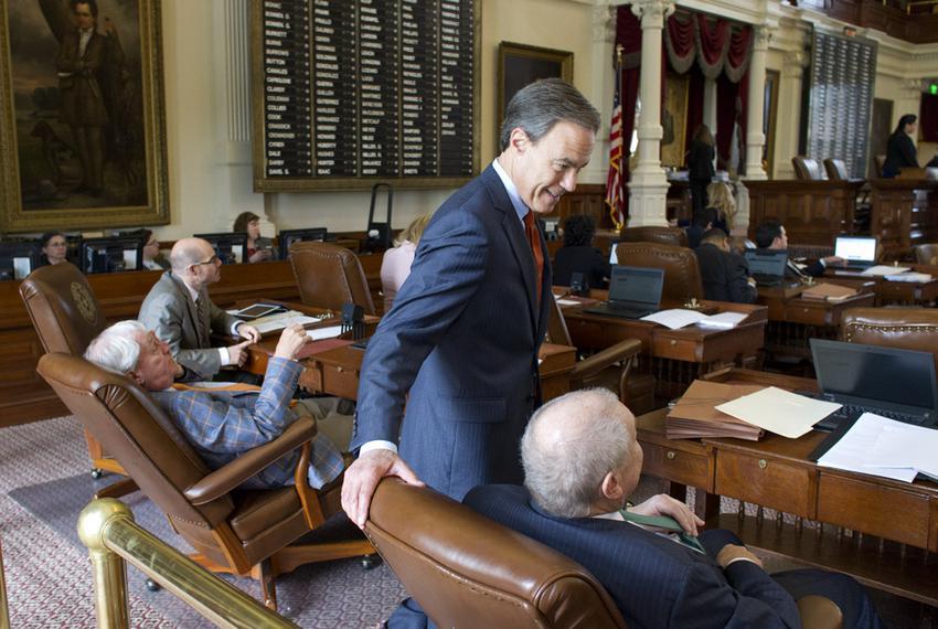 House Speaker Joe Straus, R-San Antonio, takes a break from the chair to speak with members during floor debate on May 27,...
