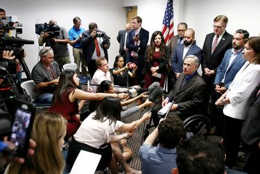 Flanked by El Paso lawmakers, Gov. Greg Abbott talks to the press after meeting with state legislators on Wednesday, August 7, 2019. From left (in front of flag): State Rep. Mary González, D-Clint; state Sen. José Rodríguez, D-El Paso; state Rep. Joe Moody, D-El Paso; Lt. Gov. Dan Patrick; and El Paso state Reps. Cesar Blanco and Lina Ortega. Also present, not pictured: State Rep Art Fierro and House Speaker Dennis Bonnen.
